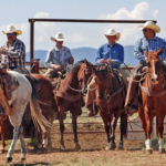 Ranchers on horseback